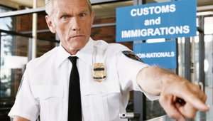 US_customs_officer_airport_small.jpg